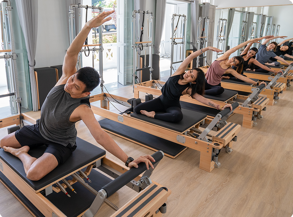 Group of people doing reformer