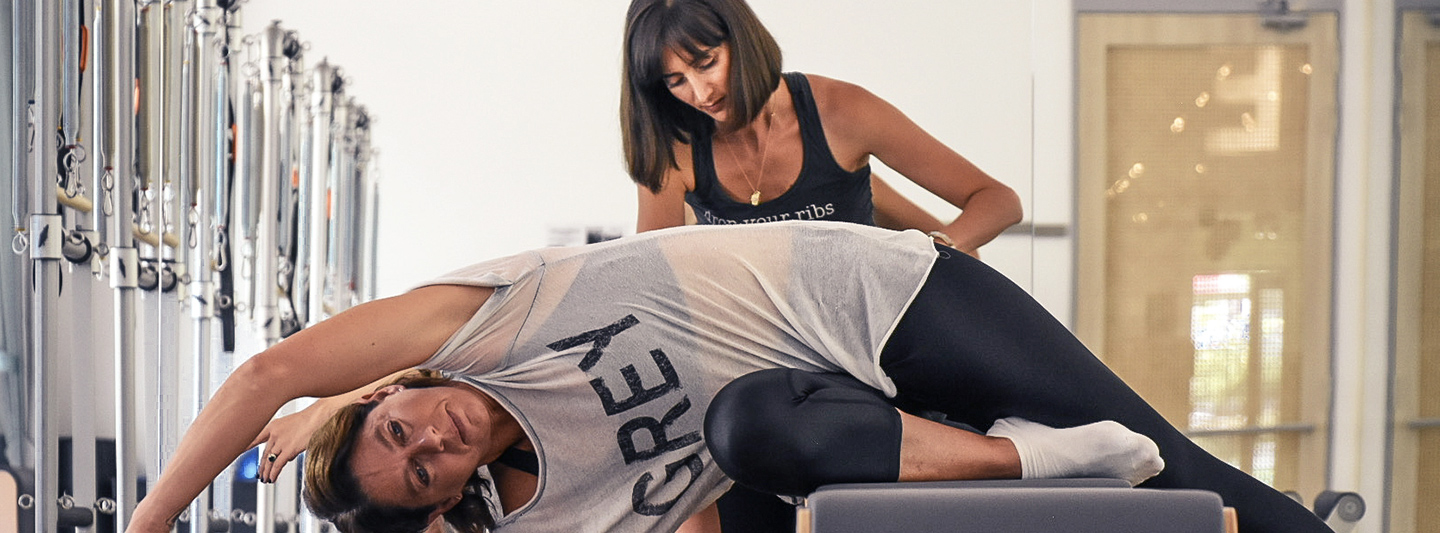 pilates instructor and client