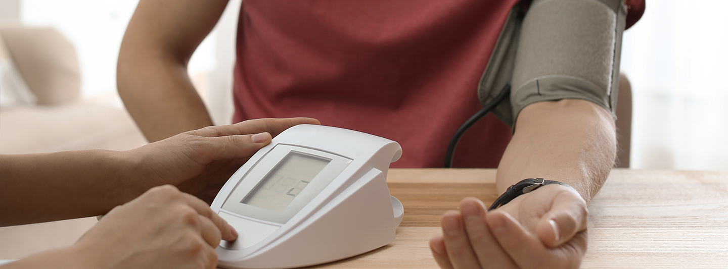 Lifestyle Assessment professional measuring blood pressure on client