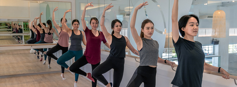 people in a barre class
