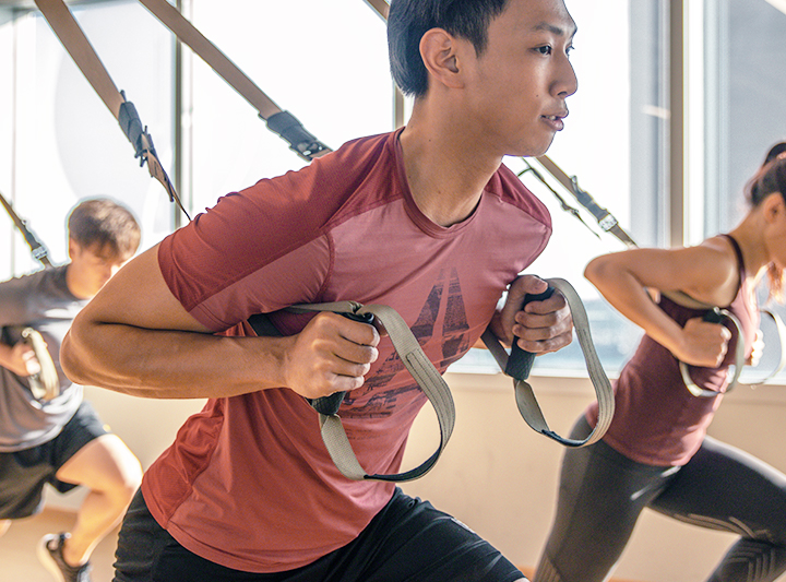 man training with TRX band