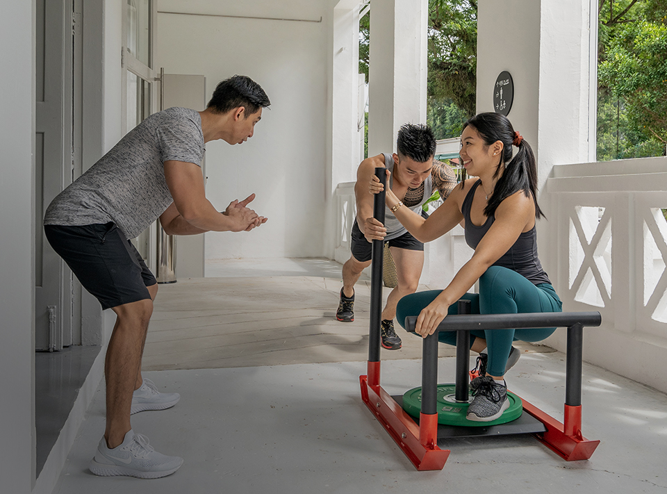 personal trainer and clients exercising outdoors