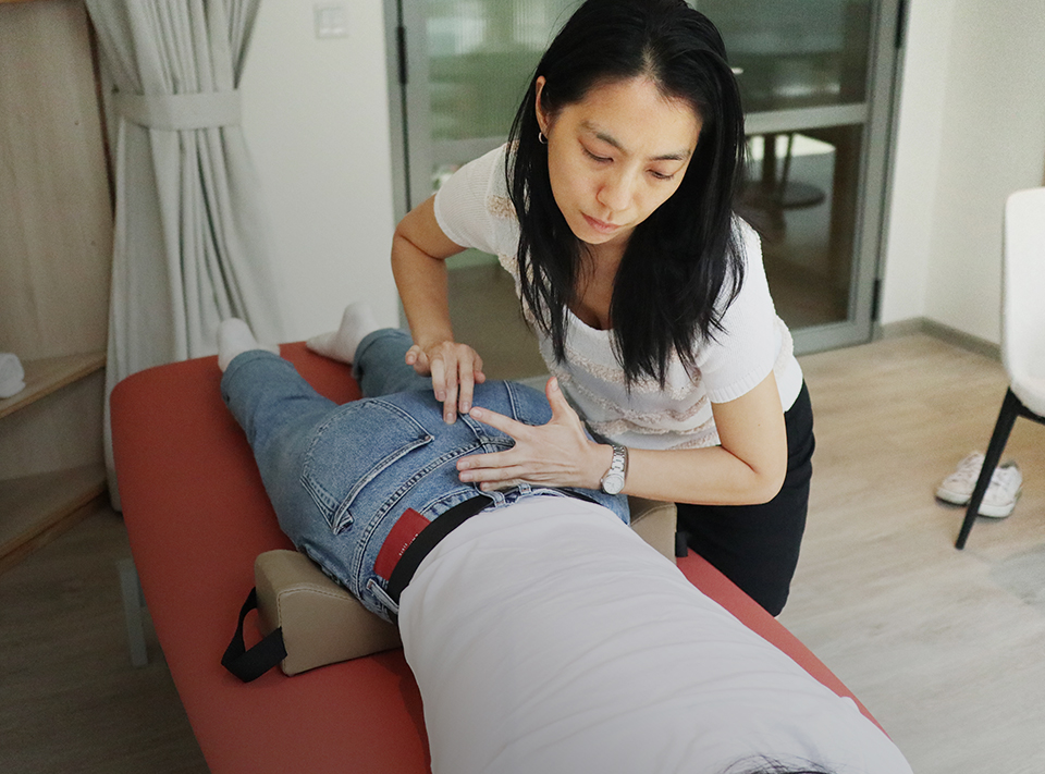 Spinal Flow Technique practitioner treating a patient