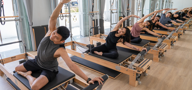 people in reformer pilates class