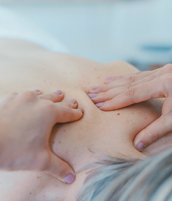 masseuse massaging a client